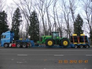 Перевозка-трактора-Джон-Дир-9530-со-спаренными-колесами-